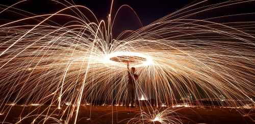 photo of man doing steel wool photography